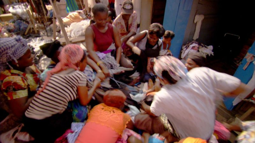 Women fight for second-hand clothes at Kejetia Market in Kumasi, Ghana (© Firecrest Films)
