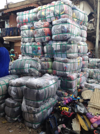 Bales of cast-off clothes in Accra, Ghana (©Firecrest Films)