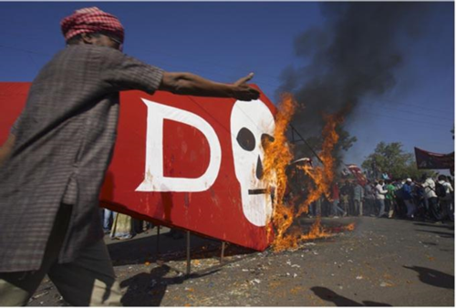 Dow logo in flames at Bhopal protest (thanks to Colin Toogood)